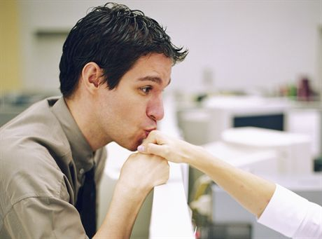 Man Kissing Co-Worker\'s Hand --- Image by © Shannon Fagan/CORBIS