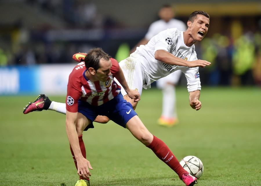 Diego Godin i Cristiano Ronaldo